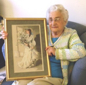 Mary Manolides displaying her cross stitch