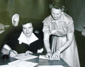 13 Georgia signing her naturalization papers, 1953