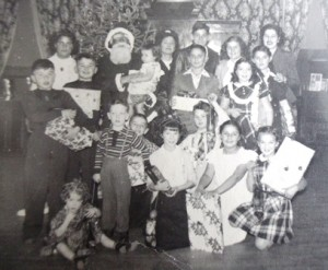 12 Christmas in Yakima, George holding package at left, 1944