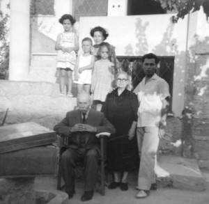 11 Dimitri with family in Athens front Emmanuel, Garyfalia, Dimitri; rear other family members, 1957