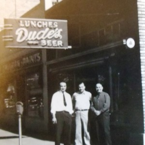 3 Paul, uncle Harry and Papouin front of Dude's, 1950s