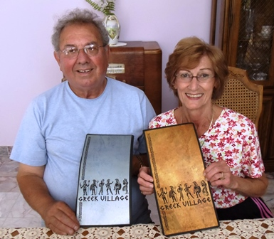 1 Petro and Colleen with Greek Village menus