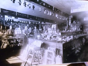 13 Store, inside with Mike on left,circa 1920