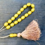 Yellow beads with large tassle