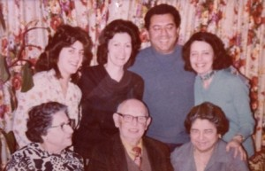 20 With family, (l-r) front, Efthelia Gregores, Nick Carras, Helen Carras; back Nikki, Colleen, Pete, VIcky Kangels 1975