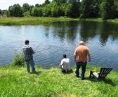 11 Bill with nephews Demetri and Kosta casting in the pond in front of the main office during a break from work.