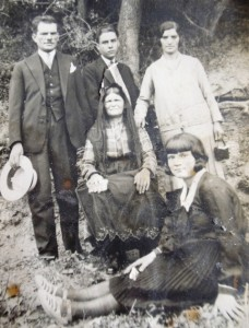 12  Penny's family (l-r) standing; father Niko, Niko, mother's cousin Sofia, seated; grandmother Penelope, front; cousin Elefteria, circa