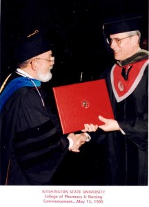 17 Angelo receives his PhD in Pharmacy, May 13, 1995