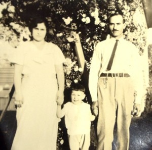 3 With parents , circa 1935