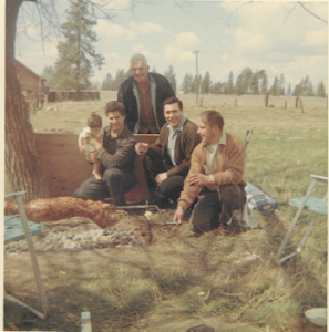 12 First Greek Easter on the farm.  Michael and baby ari, John Gormanos, Gene Theilen and Sam Triantis(background), 1968