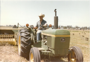 14 Bailing hay on the farm, 1985