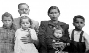 4-family-passport-l-r-in-the-photo-attached-are-george-godulas-and-naouma-godulas-and-the-kids-from-left-to-right-are-effie-tula-stella-and-john